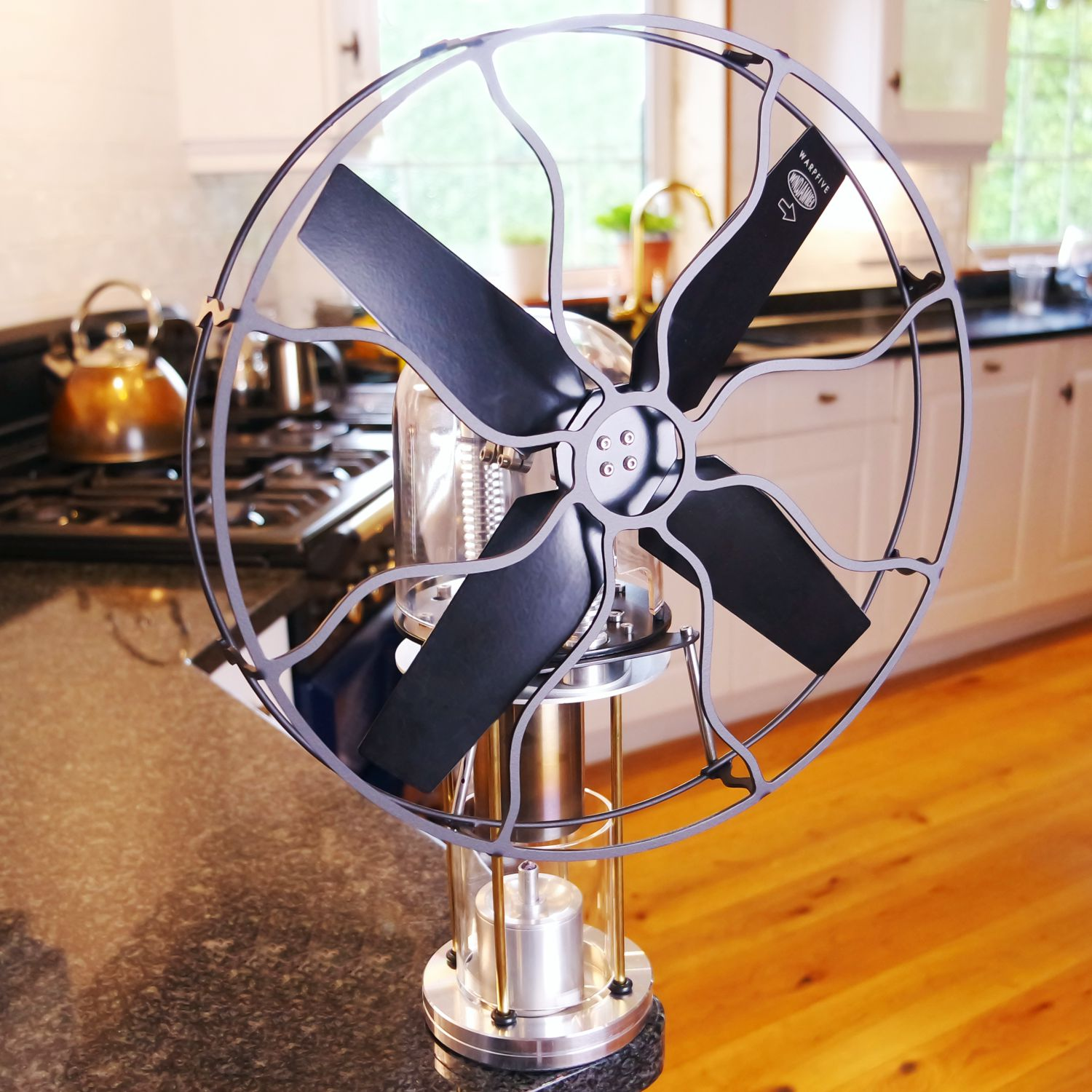 Multi-purpose table fan runs on alcohol or Methylated Spirits - spreads warm air from any heat source or cool air
